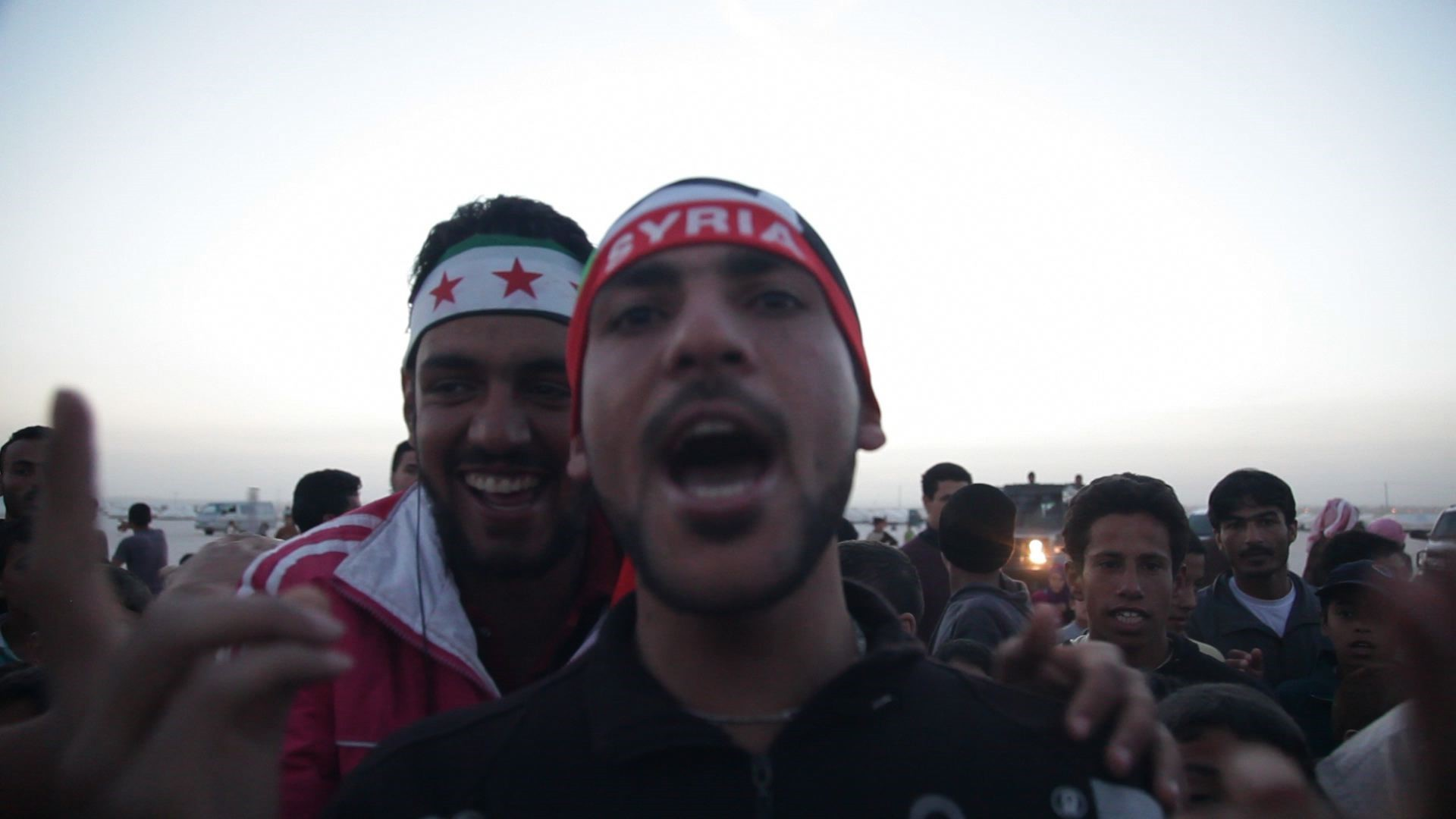 A syrian man wearing a syria beanie