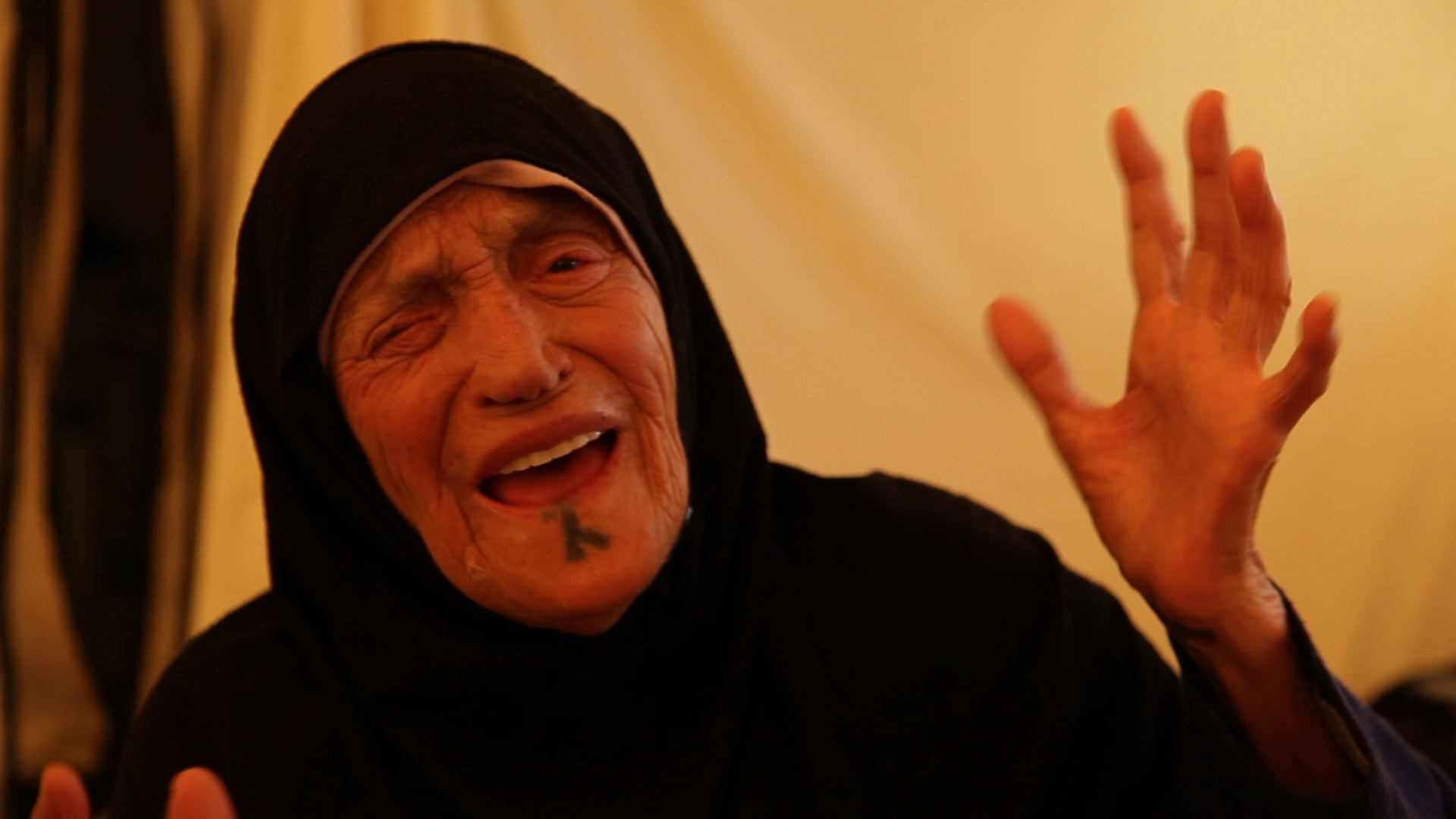 an elderly lady in syria