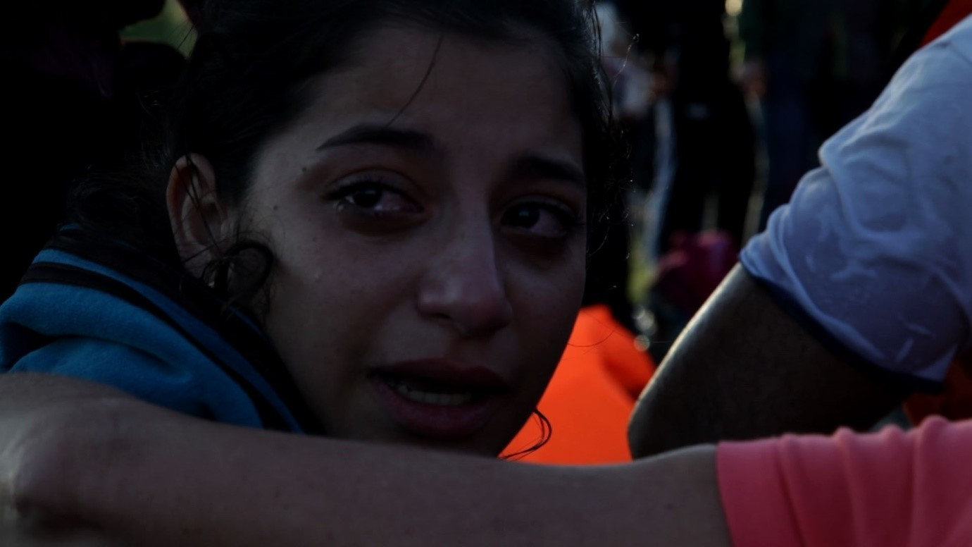 An upset refugee arriving onshore